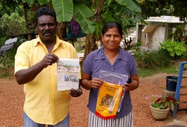 Sri Lankan residents with their new home