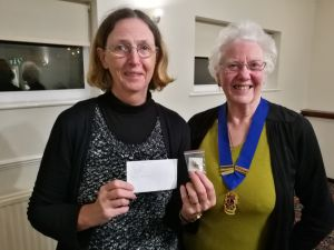 image: club member brigid receiving her badge